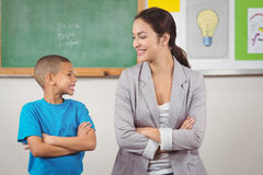 Pretty teacher and cute pupil in front of chalkboard Royalty Free Stock Images