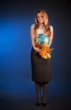 Pretty teacher with globe and maple leaves Royalty Free Stock Photos
