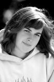 Pretty Teen. Done in B&W with warm smile. Photographed with limited DOF Stock Photography