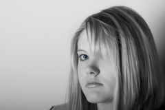 Pretty teen. With blue eyes in black and white stock images