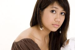 Pretty Teen 8. A pretty young woman in a brown top on white background Royalty Free Stock Photos