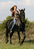 Pretty teen and black horse. Young woman and her friend black stallion Stock Image