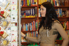 Pretty teen and bookstore royalty free stock image
