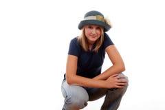 Pretty teen girl. Attractive blond teenage girl in hat kneeling Stock Photography