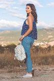 Pretty teen girl with bag over nature background Royalty Free Stock Images