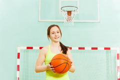Pretty teen girl with ball during basketball game Stock Photos