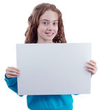Pretty teen girl with blank poster. On white background Stock Photography