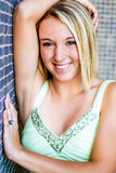Pretty teen girl with blonde hair stock photo