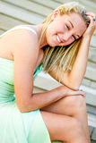 Pretty teen girl with blonde hair. Pretty beautiful young teenage girl / woman / female with blonde hair. wearing elegant mint green formal prom dress. sitting Royalty Free Stock Photography