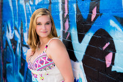 Pretty Teen Girl & Blue Graffiti Wall Stock Photography