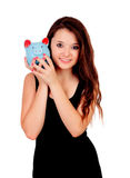Pretty teen girl with a blue piggy-bank Stock Image