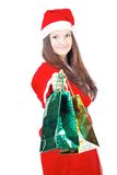 Pretty teen girl dressed as Santa gives gifts Royalty Free Stock Image