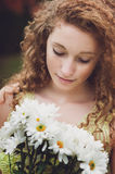 Pretty teen girl with flowers Stock Photos