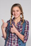 Pretty teen girl with her thumbs up Royalty Free Stock Photos