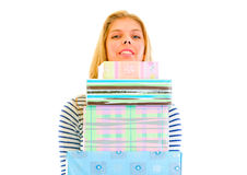 Pretty teen girl holding stack of present boxes Royalty Free Stock Photo