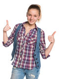 Pretty teen girl holds her thumbs up Royalty Free Stock Photos