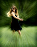 Pretty teen girl in motion blur Stock Photo