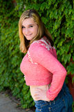 Pretty Teen Girl Pink Sweater & Green Ivy Stock Photos