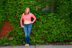 Pretty Teen Girl Pink Sweater & Green Ivy Stock Images