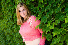 Pretty Teen Girl Pink Sweater & Green Ivy Royalty Free Stock Images