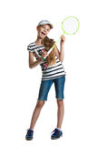 Pretty teen girl plays with a racket for a badminton on a white background. Stock Photos