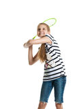 Pretty teen girl plays with a racket for a badminton on a white background. Royalty Free Stock Image
