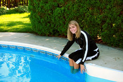 Pretty teen girl at pool Stock Photography