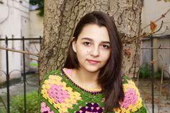 Pretty teen girl portrait. Young girl portrait wearing a colorful crochet poncho Royalty Free Stock Photos