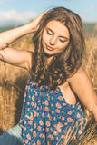 Pretty teen girl in rye field back view Royalty Free Stock Photography