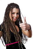 Pretty teen girl showing the thumbs-up sign. Happy young teen girl with beauty dreadlocks showing thumbs-up sign Stock Photos