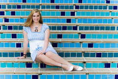 Pretty Teen Girl Sitting on Elegant Blue Steps Royalty Free Stock Photography