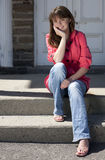 Pretty Teen Girl Sitting on Stairs Stock Photos