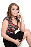 Pretty teen girl sitting Royalty Free Stock Photos