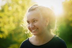 Pretty teen girl smiling in warm sunset Royalty Free Stock Photography