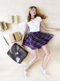 Pretty Teen Girl Student holding school bag and books with a sad expression. Girl going back to school. Pretty Teen Girl Student holding school bag and books Royalty Free Stock Images