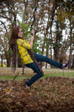 Pretty teen girl on a swing Stock Photo