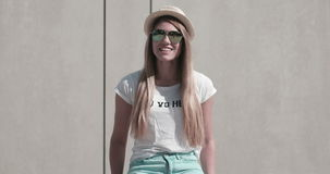 Pretty Teen Girl in Trendy Fashion outfit. Smiling at Camera stock footage