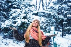 Pretty teen girl walking in city park at snow weather Royalty Free Stock Image