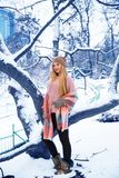 Pretty teen girl walking in city park at snow weather Royalty Free Stock Photography