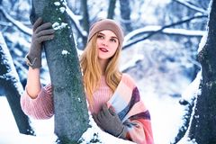 Pretty teen girl walking in city park at snow weather Royalty Free Stock Images