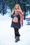 Pretty teen girl walking in city park at snow weather Royalty Free Stock Photo