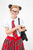 Pretty teen girl wearing school uniform and school bag. Education. Studio shot. Royalty Free Stock Images