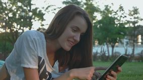 Pretty teen girl is working in internet outdoors stock footage