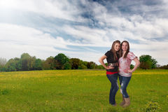 Pretty teen girls in meadow Royalty Free Stock Image