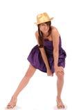Pretty teen in golden hat Stock Image
