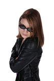 Pretty teen in leather jacket and sunglasses Royalty Free Stock Image