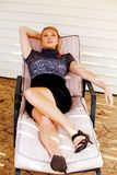 Pretty teen model in lounge chair Stock Image