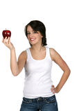 Pretty teen offering a red apple. Pretty teen holding up a red apple Royalty Free Stock Photography