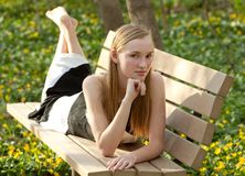 Pretty Teen on Park Bench Royalty Free Stock Image