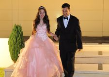 Pretty teen quinceanera birthday girl celebrating in princess dress pink party, special celebration of girl becoming woman. Love and family celebration an Royalty Free Stock Photos